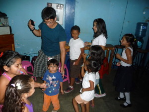 Volunteers use creative and dynamic methods to teach English to young students.