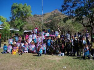 Children at the coffee camps receiving new backpacks.